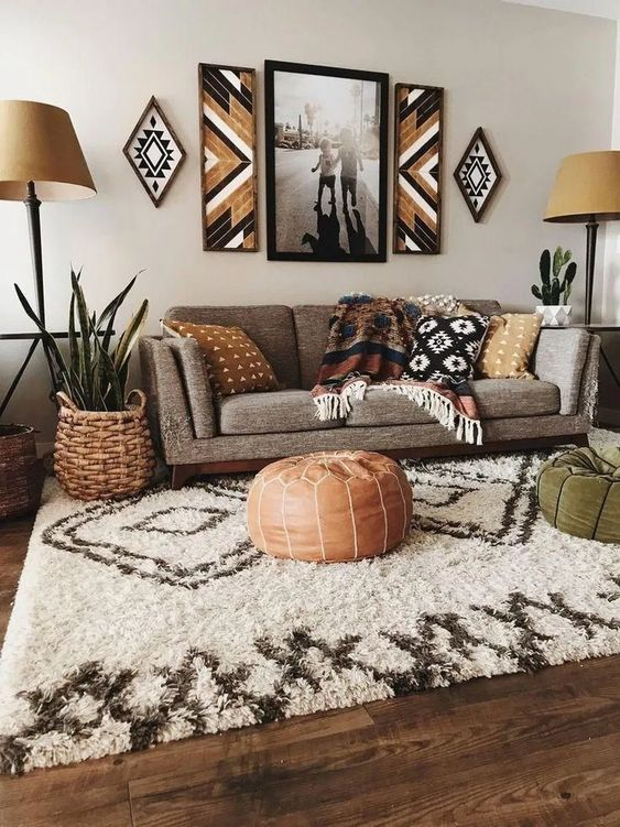 a boho living room done in earthy colors and shades with printed textiles, throws, tribal artworks