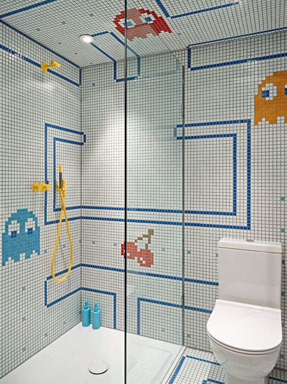 a bright and fun kids' bathroom with mosaic tiles and fun patterns, a seamless shower space