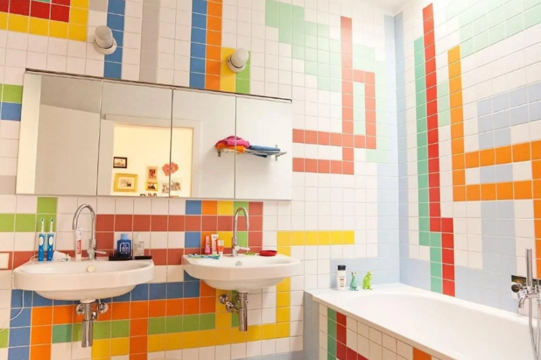 a colorful bathroom with bright tiles done in geometric patterns on the walls is a cool and cheerful idea