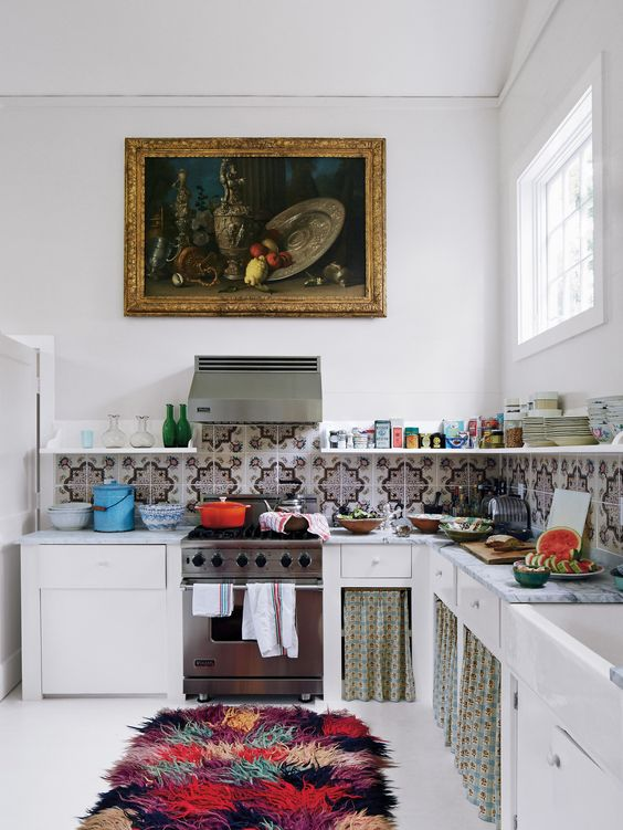 a colorful fluffy rug, a mosaic tile backsplash and some curtains give this kitchen a cool boho feel
