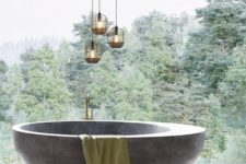 a contemporary bathroom with a glazed wall for a view, a rounded stone bathtub, catchy lamps to accent the space