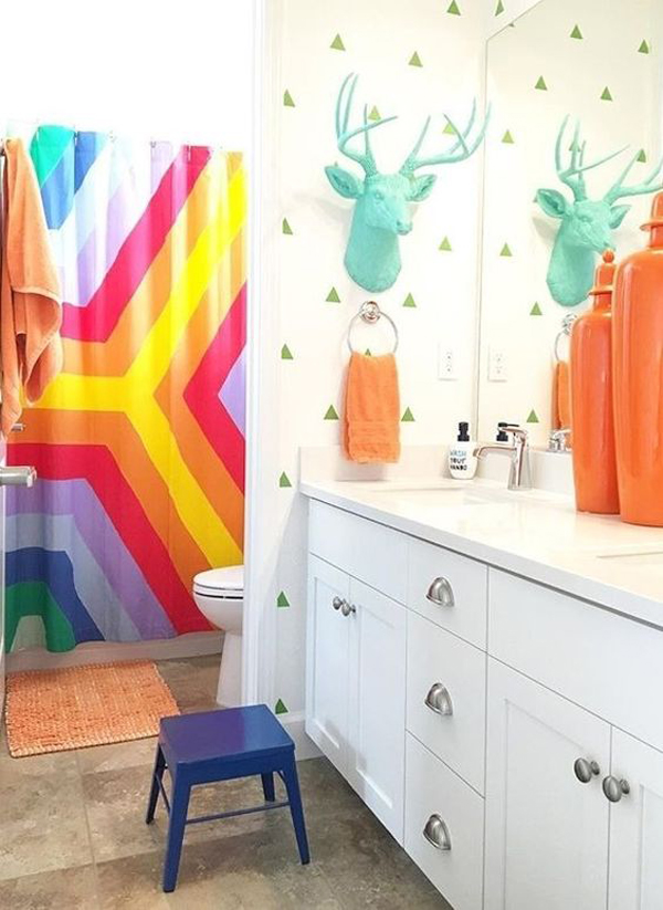 a faux turquoise deer head, colorful towels and a super bright shower curtain will turn a simple bathroom into a kids' one