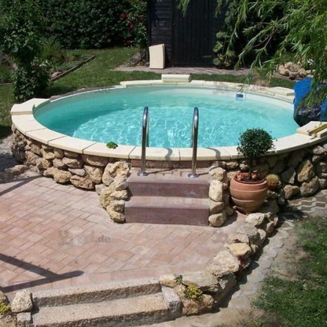 a large round pool clad with tiles and stone and with a brick deck next to it is a traditional otudoor feature to try