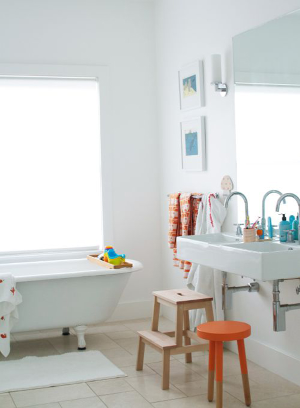 a neutral bathroom made fun and cheerful with colorful kids' accessories and furniture in all kinds of shades