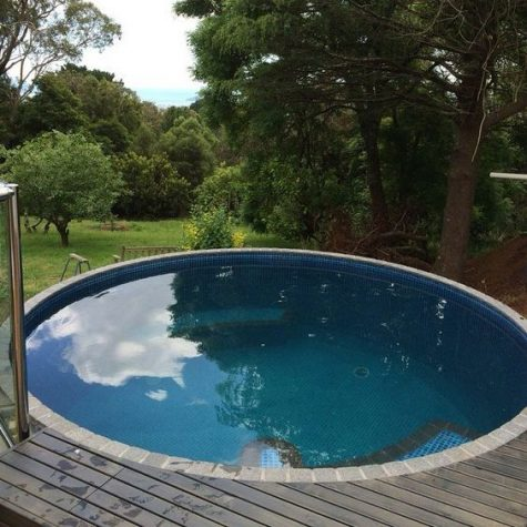 a small wooden deck with rather a large round pool look very bold and cool and the view is amazing