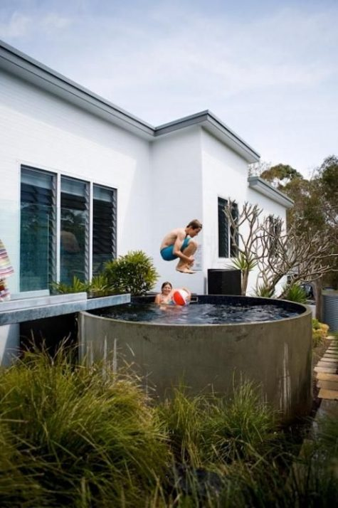 a cool pond-like pool in a small backyard