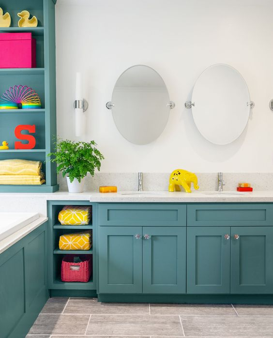 a turquoise and white bathroom with white appliances and countertops and lots of colorful accessories that make the space bold