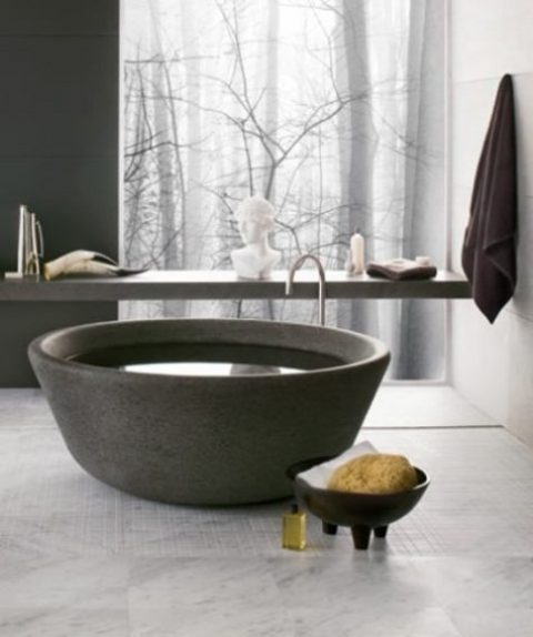 a unique bowl-like stone bathtub is an ultimate solution for a contemporary or minimalist bathroom