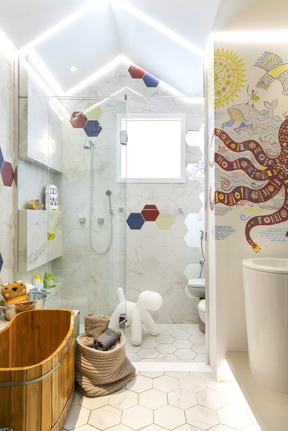 colorful hexagon tiles and a bright octopus mosaics on the wall, fun toys to make the bathroom cooler