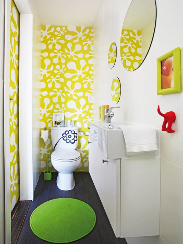 make a kids' bathroom fun with bright and quirky wallpaper, rugs, accessories and shelves on the wall