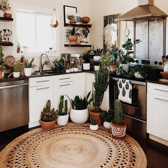 pull off a boho look with potted plants and succulents, a jute rug and some wicker touches here and there