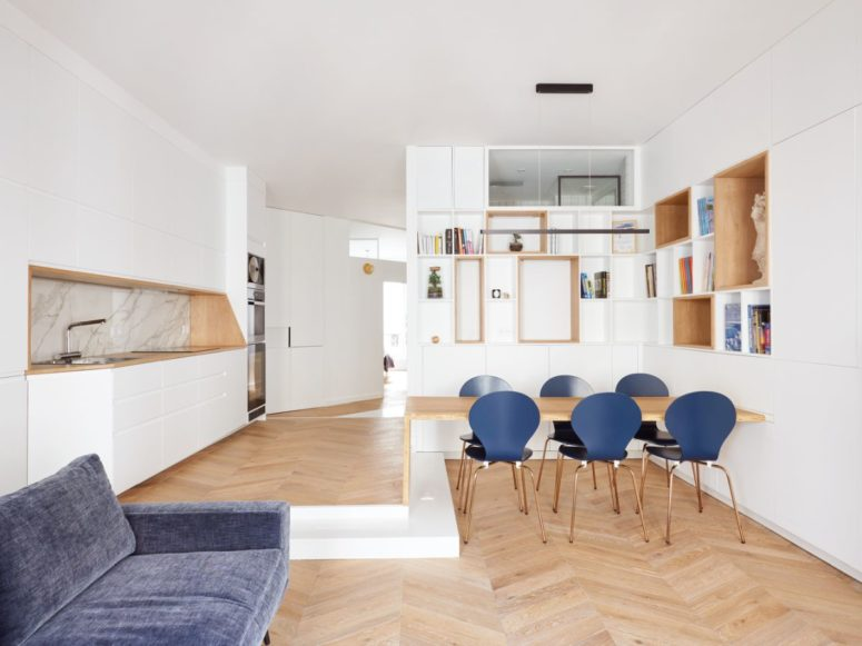 This bold Paris apartment features contemporary style, Paris chic and touches of light colored wood and blue here and there