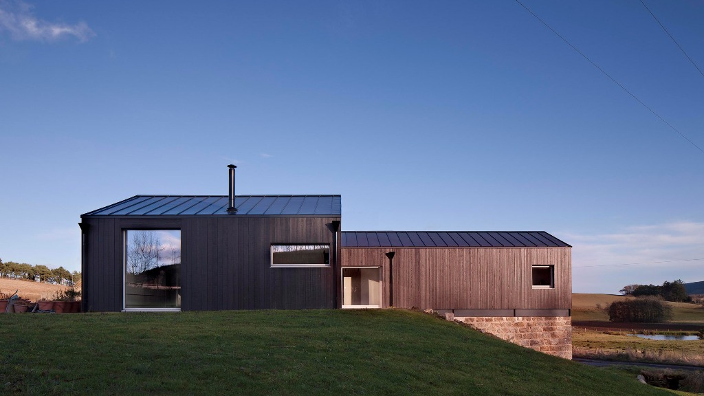 This contemporary home is built on top an old granite mill in Scotland