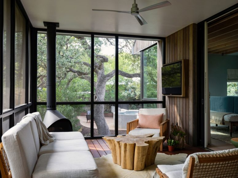 This house is a welcoming space done in an eclectic mix of modern and rustic and trying to merge with nature around it