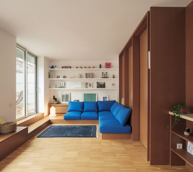 This modern apartment is a small attic of just 70 square meters and to make it effective and practical, the designers went for built in furniture