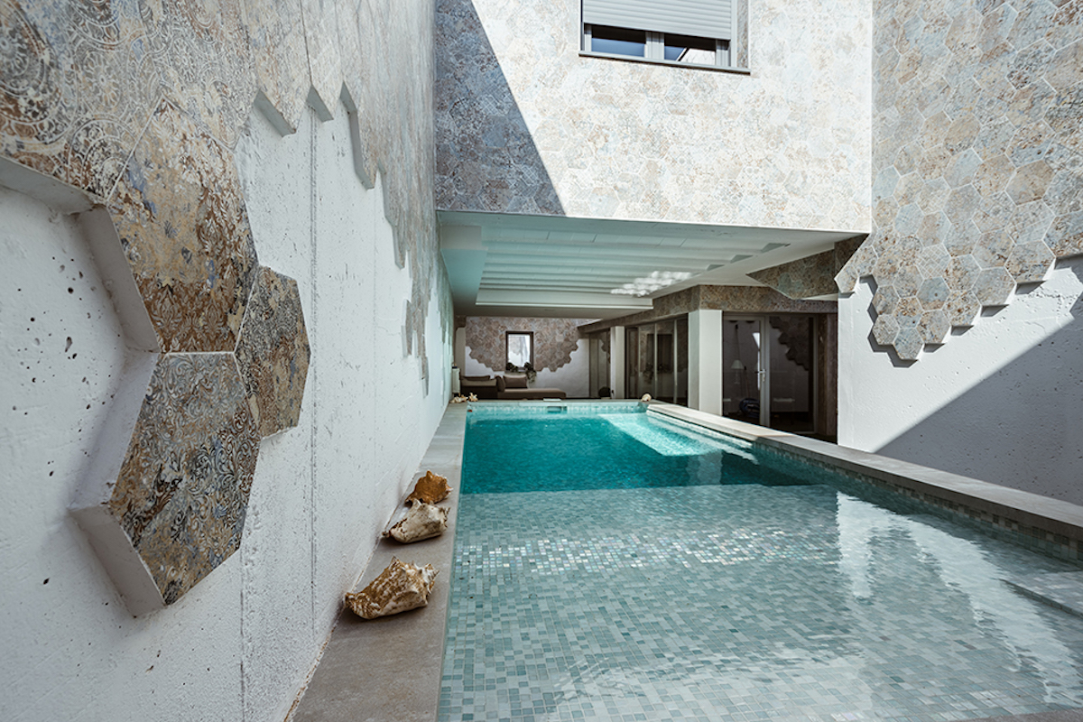 This unique house in toledo features patios that were rethought and reinvented for it completely