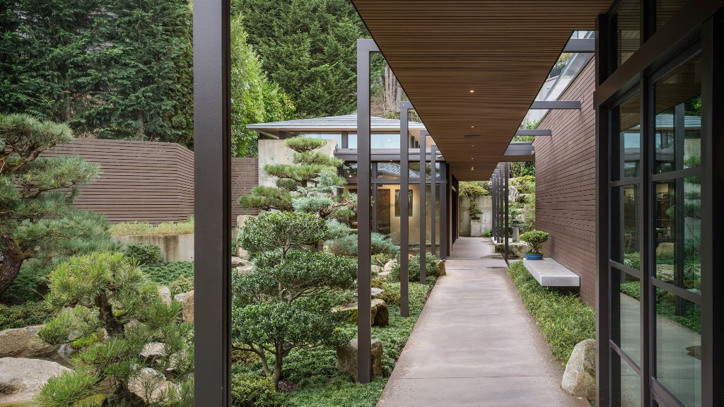 The house features a large garden in Japanese style that is at heart of this home