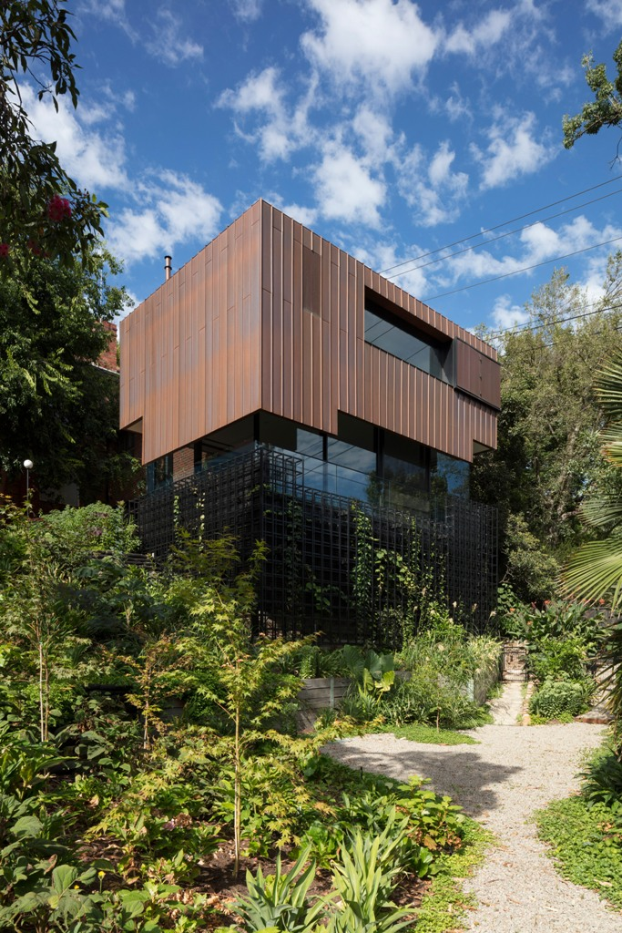 The house is clad with copper panels that will patina over time and will look like furniture inside the house