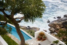 02 There's a pool, a terrace and gorgeous landscaping around, and the views of the ocean are maximized