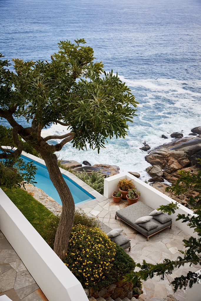 There's a pool, a terrace and gorgeous landscaping around, and the views of the ocean are maximized
