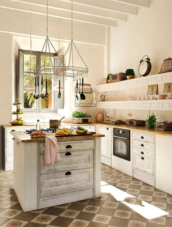 a beautiful white kitchen with a vintage-inspired whitewashed kitchen island for a trendy look