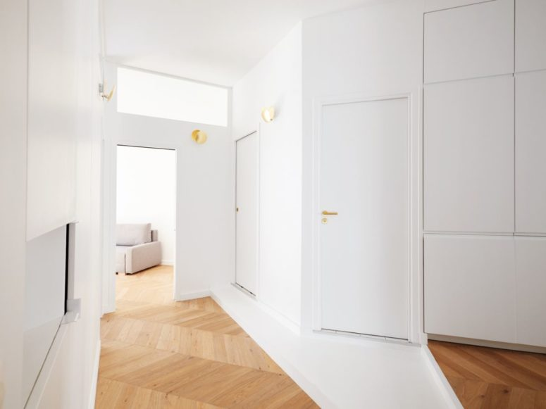 Such built-in storage units are incorporated into the whole apartment to make stored things invisible
