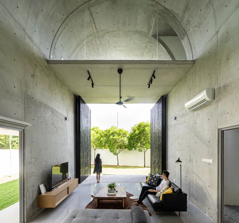 The contemporary design is continued indoors, too, with simple furniture and all concrete everything
