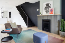 03 The living room is represented with a grene fireplace, comfy mid-century modenr furniture and a gradient rug
