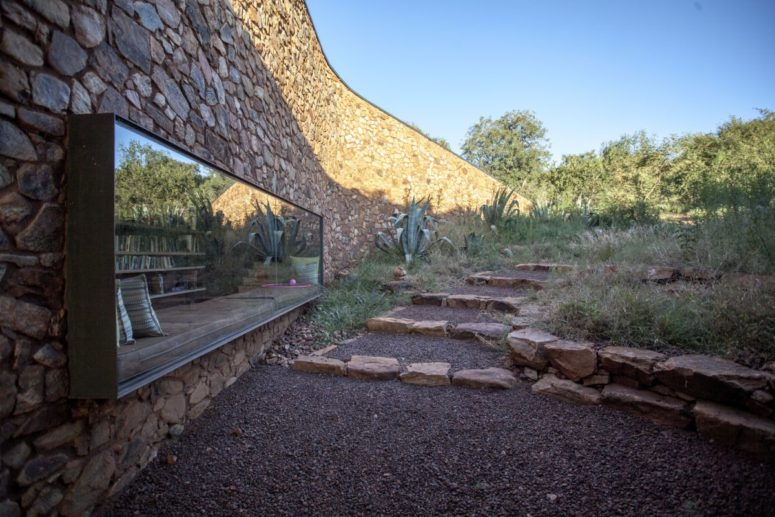 The ouse features stone walls and rammed earth ones