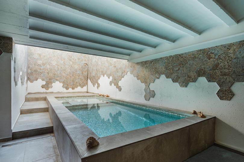 an indoor outdoor pool design