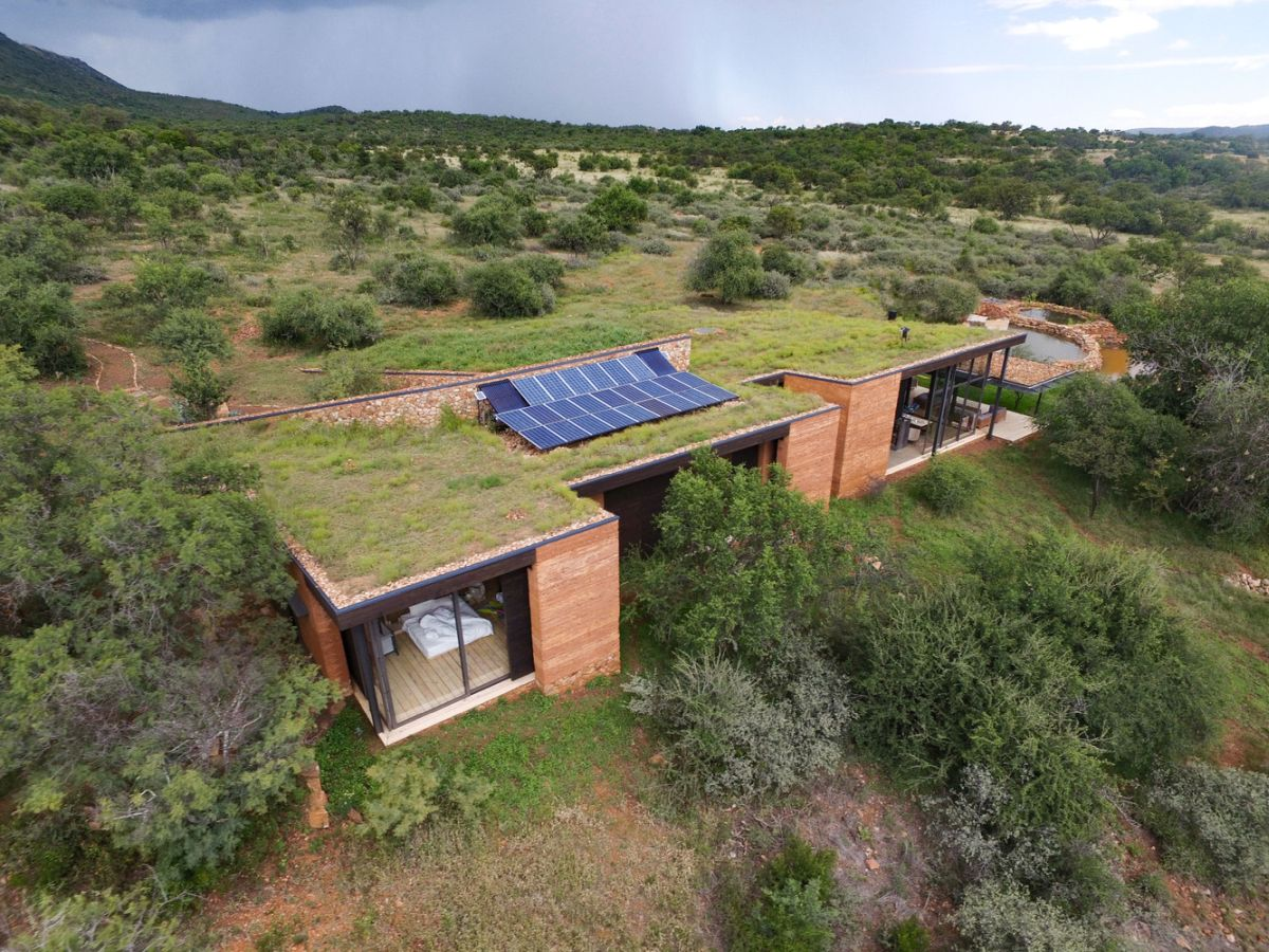 There are photovoltaic panels on the roof and they provide the house with some energy