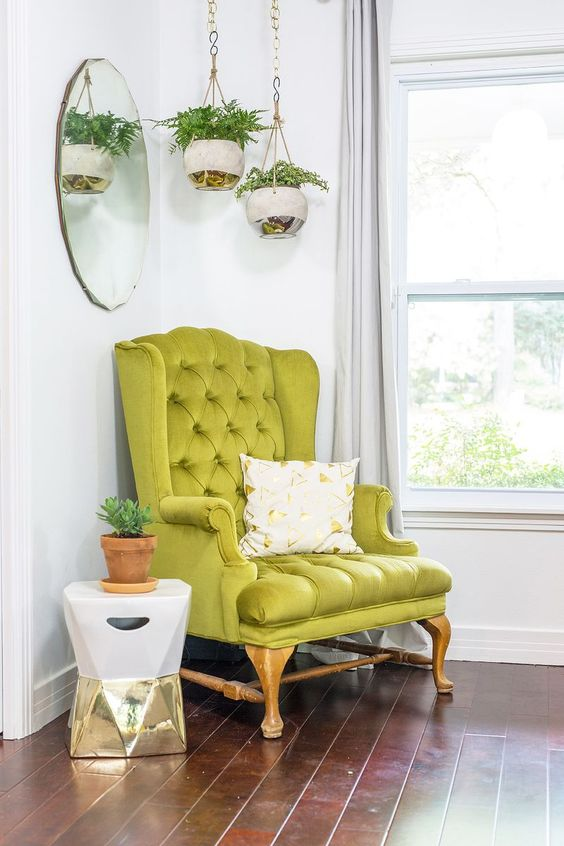 a bright modern nook with a vintage-inspired neon green chair that sets the tone in the space