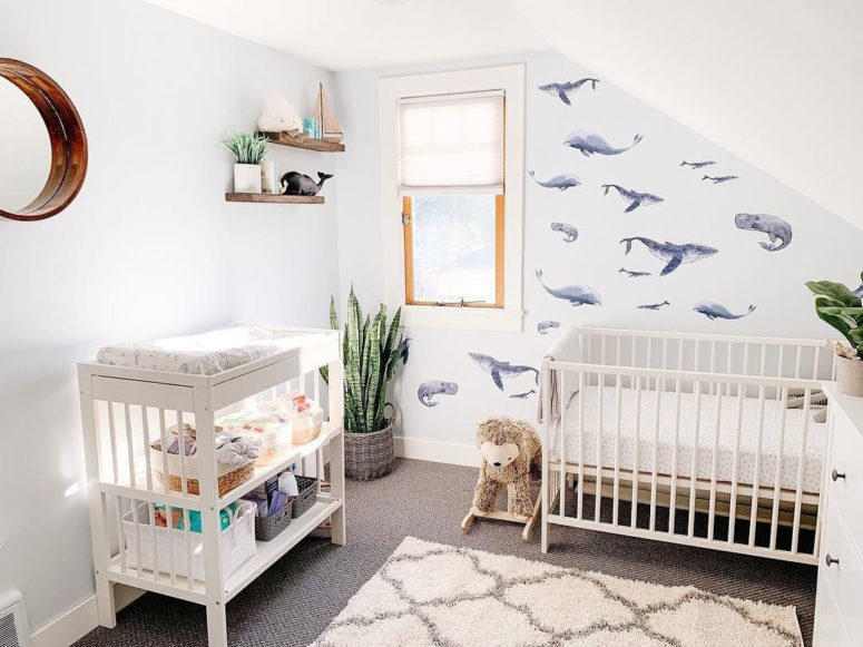 a serene bedroom with a whale print wallpaper wall for an accent is a cool and inviting space