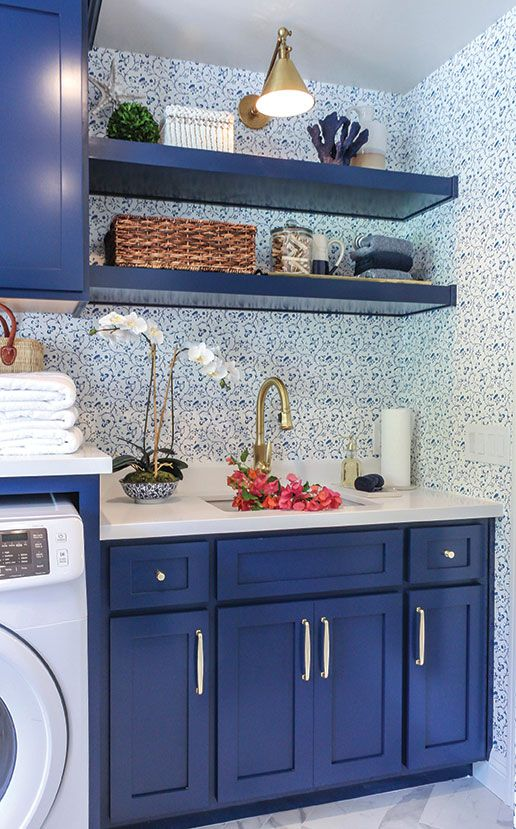 a tiny kitchen done with blueberry blue cabinets, shelves and white to maximize