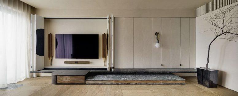 One part of the panels hides a TV unit