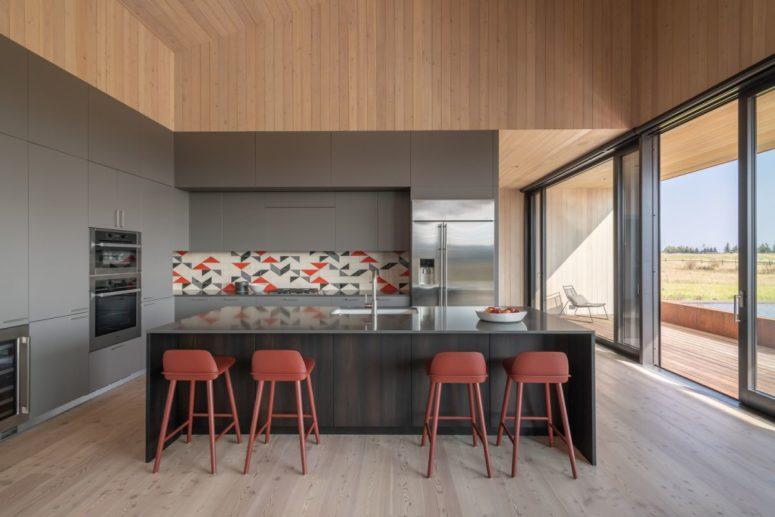 a colorful tile backsplash looks cool on minimalist ktichen