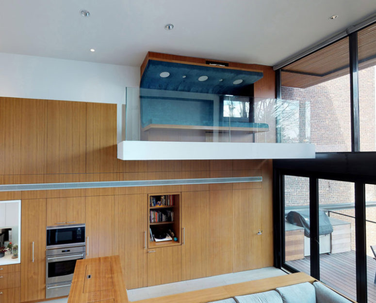 a small indoor balcony with a comfy seating