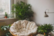 05 a cozy reading nook with a papasan chair with a neutral futon and lots of potted greenery