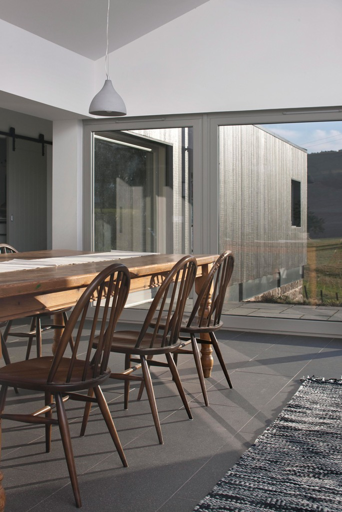 Glazed doors and large windows fill the spaces with light and show off cool sceneries