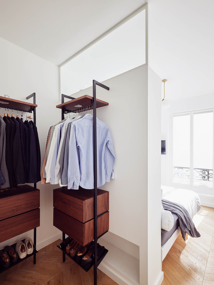 One of the bedrooms features a small yet well-organized and comfortable closet