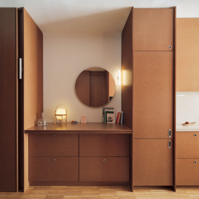 The entryway is done with cabinets of the same shade as the kitchen to make the space continuous and harmonious