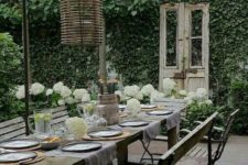 06 a garden dining space with vintage and shabby chic furniture, wicker lamps and living walls all around