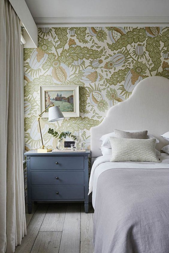a neutral bedroom spruced up with pastel and muted color botanical wallpaper with abstract prints