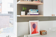 07 Bold artworks and potted plants refresh the spaces making them stand out a lot