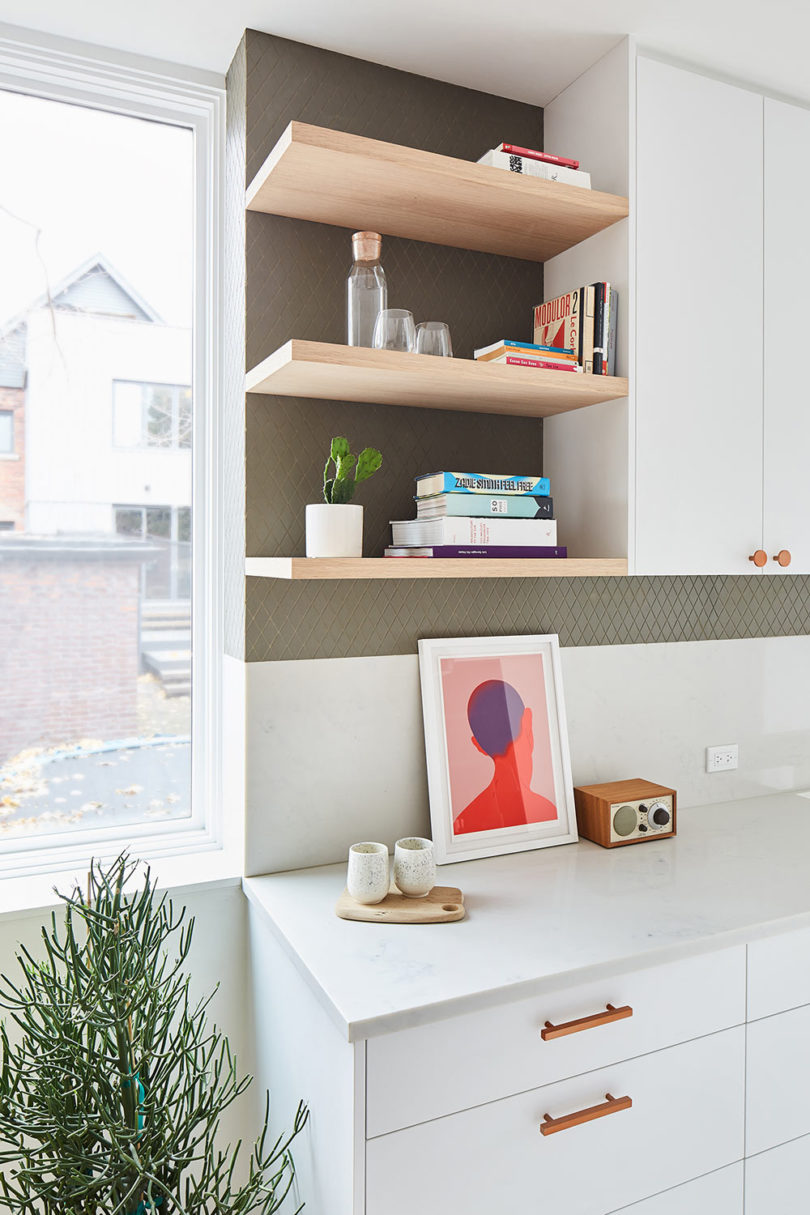 Bold artworks and potted plants refresh the spaces making them stand out a lot