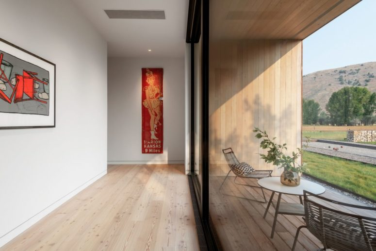 Large windows bring in lots of light and also expose the internal spaces to the panoramic views