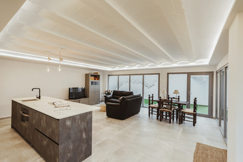 The main space is an open layout uniting a kitchen, living and dining room