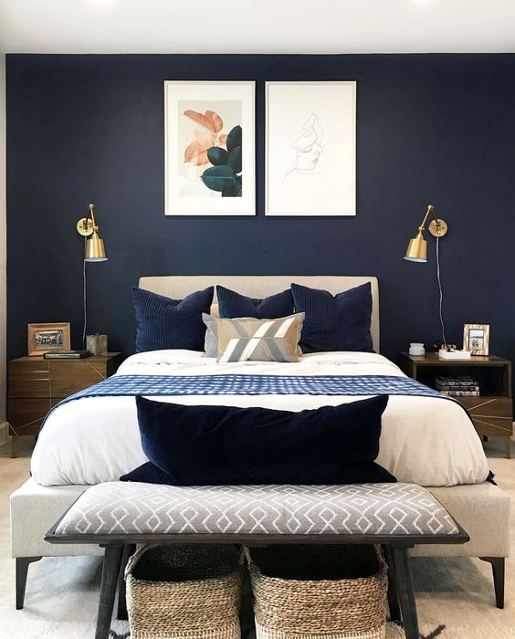 a mid-century modern bedroom with gold wall sconces is a cool space with a shiny touch