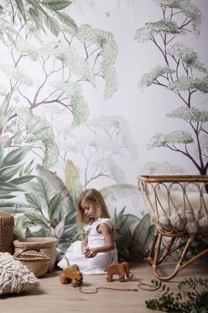 use botanical print wallpaper in the nursery to give it a peaceful and natural feel and match the furniture with this wall