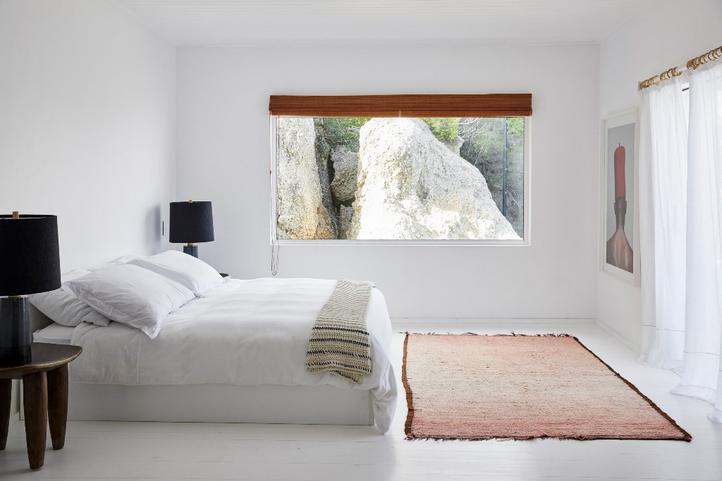 Another bedroom features a rock view, quirky furniture and art